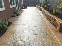 Concrete sidewalk with retaining wall