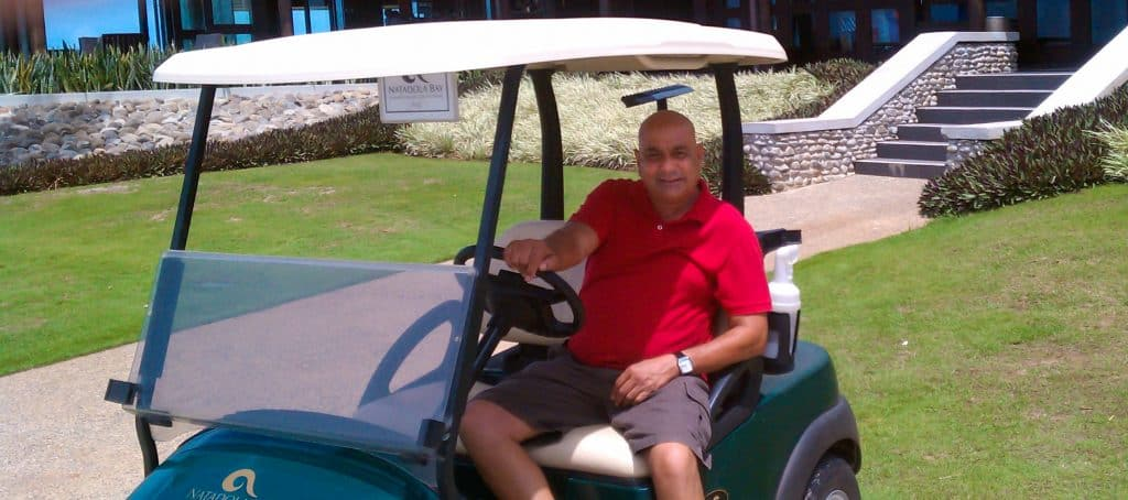 photo of Salen Singh on a golf cart